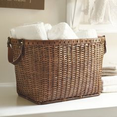 "Oval Rattan Basket with Leather Handles - $89 - 11 7/8""H (w/out handles) X 19 7/8""W X 13""D"