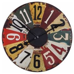 Add a little whimsy to any room with this license plate clock by Uttermost. Each number is a slice of an expired plate. This would also make a great gift for any car buff.
