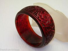 Lovely vintage Chinese export carved cherry amber bangle.