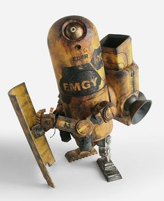 Photos of the EMGY Armstrong 1G toy holding a EMGY Dropcloth Shield from the World War Robot Collection by ThreeA based on designs from Ashley Wood.