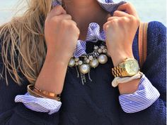 Business casual work outfit: navy sweater, purple striped button up and pearls. I'd wear with jeans & boots.