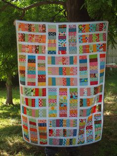 Love this quilt. What a great easy way to use up those scraps. Can you say quilt in a day?! I can!