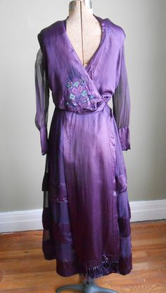Purple silk dress with embroidered design, circa 1915-18 via Etsy | Measurements: 37-26-free
