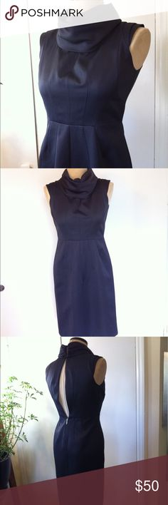 """Zara Navy Cowl Neck Sleeveless Cocktail Dress M Gorgeous structured architectural dress has a high funnel / folded collar, sexy backless style, andknee length skirt. Dress is a midnight blue almost a very dark eggplant color. Fully lined. Exposed back. Dress has two eye hook close at collar, and 11"""" exposed zipper at the waist.It's in excellent condition.  MEASUREMENTS. The dress' stated size is M.  SHOULDER: 18"""" BUST: 39"""" WAIST: 29"""" HIP: 40"""" LENGTH: 39.5"""" top of the bustline; SWEEP: 40""""…"""