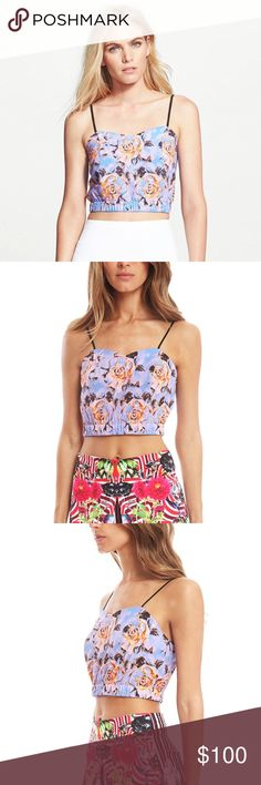 Clover Canyon Purple Floral Maze Crop Top A charming floral print crop top by Clover Canyon. Featuring a sweetheart neckline, adjustable spaghetti straps and a banded hem. Wear with a high waisted skirt for a completed look.   - 96% Polyester 4% Spandex - Made in U.S.A.  - Hand Wash Clover Canyon Tops Crop Tops