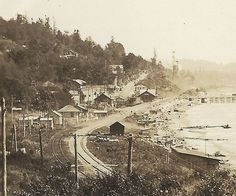 https://flic.kr/p/Dfx8me | C. 1924 Photo - Looking East at the West End of White Rock, B.C. | View of the Beach, Beach Shacks, Baggage Sheds, Pier, Railway Tracks and Business Section of White Rock, B.C. in the 1924 era.