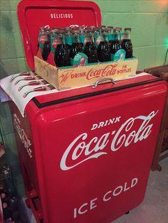 Coca Cola Christmas bottles atop original vintage Coca Cola ice chest