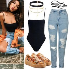 Madison Beer posted a picture on instagram wearing a Kimia Bodysuit ($119.00), the Cruxe Choker ($129.00), a Binx Chain Choker ($129.00) and a Fina Velvet Choker ($49.00) all by Are You Am I, jeans like the Topshop Moto Super Rip Bleach Mom Jeans ($85.00), and Fenty x Puma by Rihanna Camouflage Printed Leather Creepers ($195.00).