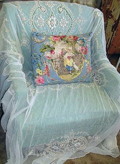 I love this look, would never thought of it... have a blue chair and a lace tablecloth, will be doing this.