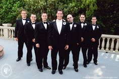 Groomsmen with black bow tie; groom with white.