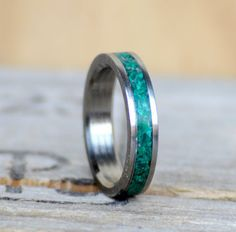 This ring is a Thin Stacking Band, Titanium (metal) with Green Malachite Stone Inlay. Additional wood and inlay options available upon request.  We love to hear your ideas. Please message us with custom ring ideas, or if you want anything special included/changed in this ring. Remember that we do different metals for the inner band. This ring can come with either STAINLESS STEEL, TITANIUM, SILVER, YELLOW GOLD, WHITE GOLD, or ROSE GOLD  We make all our rings from handcrafted materials, and…