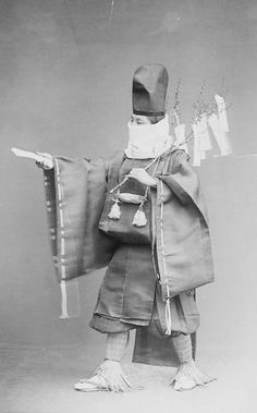 Shinto Priest in Costume, Carrying Hondawara Branch with Strips of Paper Representing Offerings. About 1880's, Japan, by Ogawa, Isshin. Smithsonian Institution, Freer Gallery of Art and Arthur M. Sackler Gallery Archives