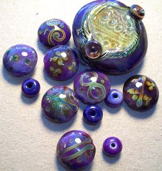"""My """"Ocean Urchin Egg"""" XL focal in """"Electric Orchid"""" and """"Electric Orchid"""" batik lentils by Genea Beads"""