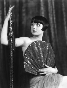 LOUISE BROOKS, famous stage and screen actress, also modeled for artists and fashion designers. She was the inspiration for the flapper comic strip Dixie Dugan.