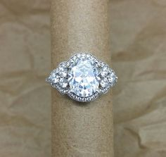 Oval embrace engagement ring. Charles Colvard Forever Brilliant moissanite.