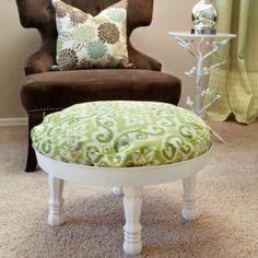 I love this ottoman. Any round cushion would work for this project. You will also need an aluminum water-heater drain pan, four table legs, four nuts, four washers and spray paint. OR you could find a small round table  and make it into an ottoman. Either way isn't hard.
