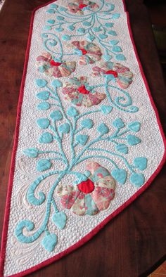 Table runner. Hand applique. Machine quilting, Flowers. Aqua and red. This is a better picture than yesterday!!!