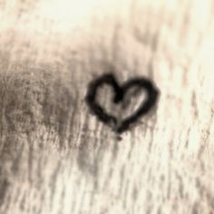 Shot with iphone and macro lens - a piece of tissue with heart sign