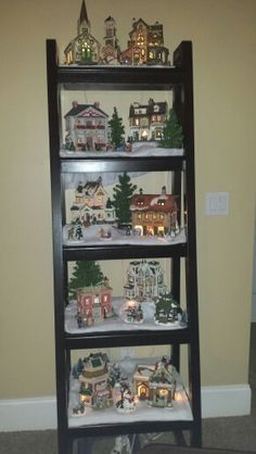 Christmas Village on tiered Ladder shelf. Love how this turned out. Christmas Tree Village, Christmas Town, Christmas Villages, Merry Little Christmas, Country Christmas, Winter Christmas, Christmas Mantles, Victorian Christmas, Christmas Christmas