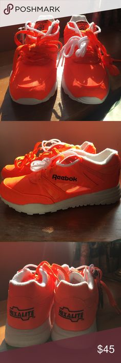 Reebok Ventilator Sneaker Never worn neon orange white and black reebok sneaker. Throwback 90's style street chic sneaker with strategically placed mesh panels to keep feet cool and dry. The honeycomb Hexalite midsole is designed to disperse shock and provide lightweight comfort and support. Reebok Shoes Sneakers