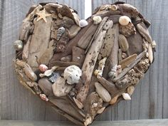Rustic Beach Decor Natural Driftwood and Sea Shell Heart- Made to Order. $46.00, via Etsy.