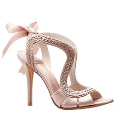 What a pretty shoe! Delicate, unusual and feminine. the braiding and the unusual shape of the braid makes it a standout. The Emmy DE by Stuart Weitzman. $430.