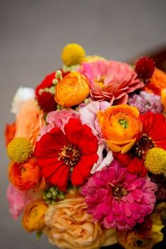Ranunculus, zinnia - bright colors, want to add purple and blue thistle and maybe a little green for all Fall colors