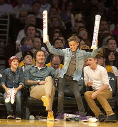 Beckham Cheerleaders! With his brothers Cruz (far left) and Brooklyn (far right) and dad David looking on, Romeo Beckham, 10, boogied at the  L.A. Lakers game at the Staples Center.