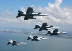 RAAF F/A-18F Super Hornets fly towards Brisbane