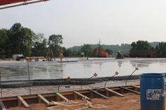 Moving right along! Slab was poured this week at the future home of Miller's Minuteman Press. 7.10.14.