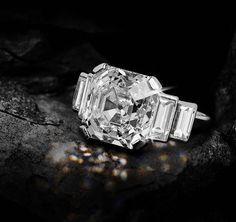 Asscher-cut diamond, weighing 6.82 carats, is D colour, potentially flawless. Circa 1940