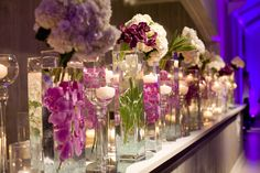 modern purple and white floral display with candles