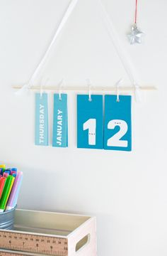 You'll flip for this daily calendar wall hanging with the happiest numbers you'll ever meet.