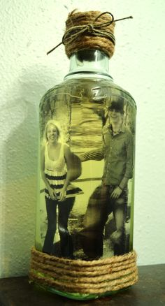 Bottle photograph of me and my boyfriend that I made in less then half an hour with a bottle of olive oil, hemp, twine, hot glue. And of course, a cute picture.