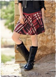Printed in a contemporary plaid, the short skirt flares out from a wide, flat yoke.
