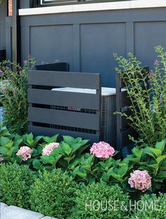 We love how designer Sarah Hartill built simple slatted walls to hide the air conditioning unit in her front garden. | Photographer: Donna Griffith