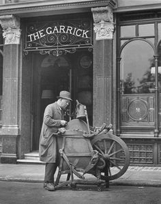 Knife grinder, Charing Cross Road, London, 1937