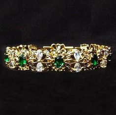 The Garland bracelet was on of Jackie's favorite bracelets given to her by JFK. It was made of emeralds and she loved that the pattern captured the outline of a butterfly. These beautiful creatures represented the freedom she never had. Years later, she had a second one made with rubies and then finally a third with sapphires. Jackie eventually owned all three of these beloved bracelets at the same time.