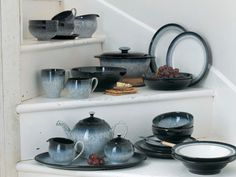 Denby - Halo dinnerware collection. Has a handmade pottery look with black/blue/gray color palette.