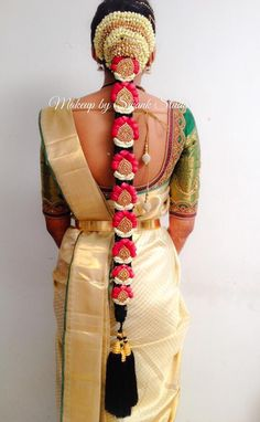 Traditional Southern Indian bride's bridal braid hair. Hairstyle by Swank Studio. Silk Saree. Sari Blouse Design. Hair Accessories. Temple jewelry. Jhumkis. Silk Kanjeevaram sari. Braid with fresh flowers. Tamil bride. Telugu bride. Kannada bride. Hindu bride. Malayalee bride. Find us at https://www.facebook.com/SwankStudioBangalore