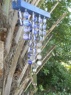 Bottle Cap Wind Chimes - primitive but appealing...! Maybe that's what I'll do with all my Blue Moon bottle caps!