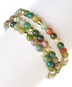 A mix of moss jade and jasper wraps your wrist with earthy appeal. Wear one or all three of these stretch bracelets for various styles.