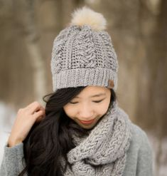Crochet this gorgeous beanie with a double brim, braided cables and the perfect amount of slouch!