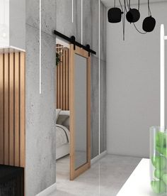 Bedroom barn doors with mirror. Modern apartment with long grey hall and sliding doors. Grey Hall, Bedroom Barn Door, Sliding Doors, Barn Doors, Gray Interior, Models, Wooden Walls, Space Saving, Tall Cabinet Storage