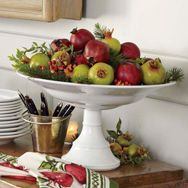 pretty way to bring Christmas colors to the buffet table....pomegranates with a little greenery tucked in.  Williams-Sonoma