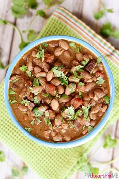 """Slow Cooker Charro Beans ~ these """"cowboy beans"""" are loaded with bacon, garlic, tomatoes, herbs, and spices, making them an excellent side dish to any Mexican entree! 