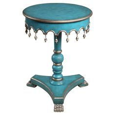 An eye-catching canvas for a vase of bright blooms or your favorite family photos, this turquoise-hued pedestal end table showcases a turned column and hangi...