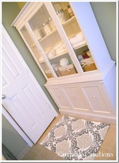 Cool idea~~~Blogger used an 'curbside find' china hutch/buffet in her bathroom for the storage she need.  Of course 'AJ' went through a few transformations!