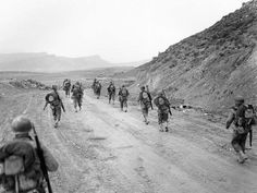 Soldiers from the Big Red One marching through the Kasserine Pass in North Africa; Tunisia, 1943