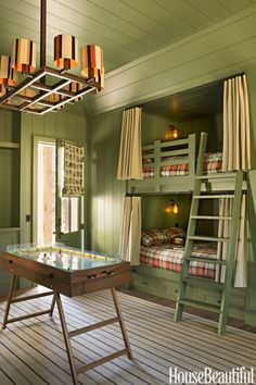 In aboys' room at aLake Tahoe mountain home, curtain-shaded bunks in Farrow & Ball's Calke Green are inspired by Pullman train cars. Not a bad room to grow up in, right?